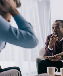 therapist listening to his client