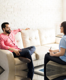 man having a discussion with a woman